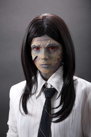 Funny concept of zombie office worker, studio shot  photo