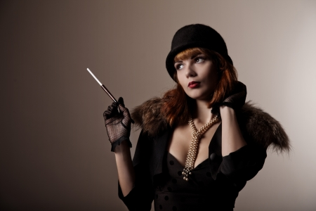 Artistic shot of beautiful retro woman in hat  photo