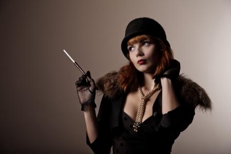 Artistic shot of beautiful retro woman in hat  photo