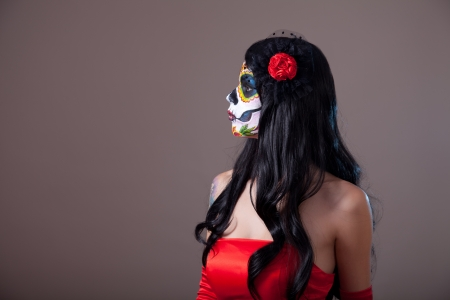 girl in red dress: Profile view of Sugar skull girl in red dress, copy-space for your text