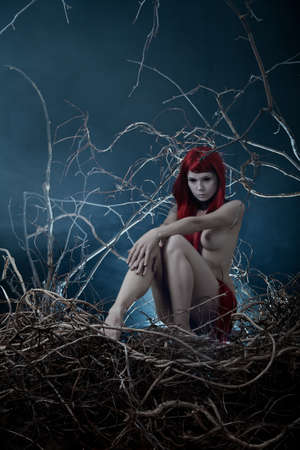 hot breast: Pale redhead nude woman in forest, Halloween theme  Stock Photo