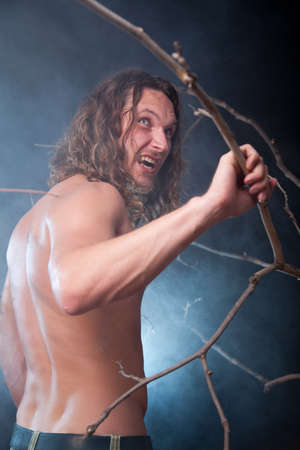Screaming long haired nude man in the forest, Halloween theme  Stock Photo - 15719500