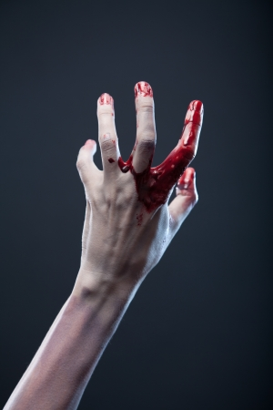 creepy hand: Bloody zombie hand, extreme body-art, studio shot
