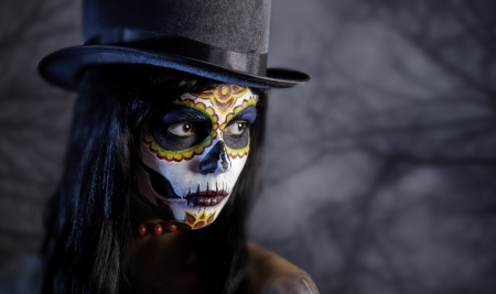 day of the dead: Sugar skull girl in tophat in the forest, Halloween theme