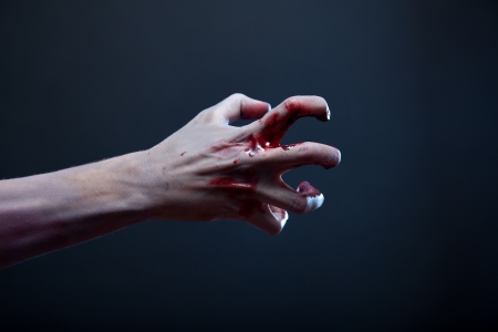 creepy hand: Bloody zombie hand, real body-art, studio shot