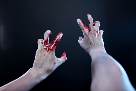 Zombie stretching bloody hands, first person point of view