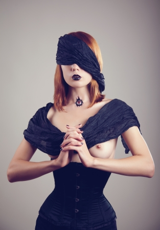 red breast: Topless young woman with eyes covered with black scarf, and eye in throat, Halloween theme