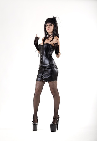 Gothic woman in sexy leather outfit, studio shot on white background Stock Photo - 16855458