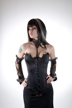Gothic girl in black corset, studio shot over white background Stock Photo - 17399916