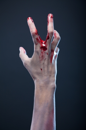 Bloody zombie hand, studio shot  Stock Photo