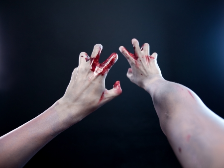 Bloody zombie hands, first person view   photo