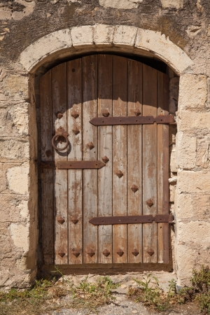 Old wooden door with metal decor in monastery Touplu, Crete, Greece  photo