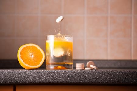Vitamin C healthy lifestyle concept – orange, tablet stack, dissolving tablet