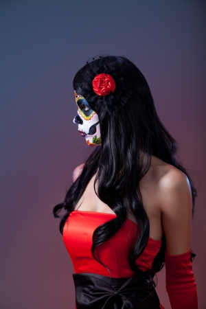 Profile shot of sugar skull girl, Day of the Dead, Halloween theme  photo