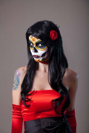 Girl with sugar skull makeup, Day of the Dead, Halloween Stock Photo - 22012329