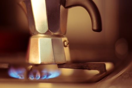 Italian coffee maker on stove, artistic photo with shallow depth of field  photo