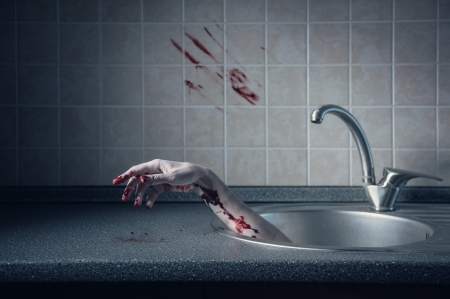 Bloody hand in kitchen sink, Halloween concept  Stock Photo