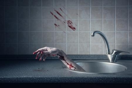 bloody hand print: Bloody hand in kitchen sink, Halloween concept  Stock Photo