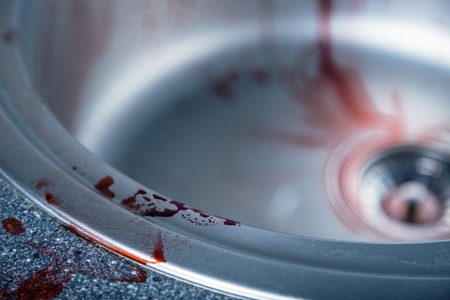 domestic scene: Close-up shot of blood on kitchen sink, Halloween or crime theme  Stock Photo