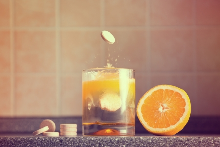 Artistic shot of vitamin C family, orange, tablet stack, dissolving tablet  Standard-Bild
