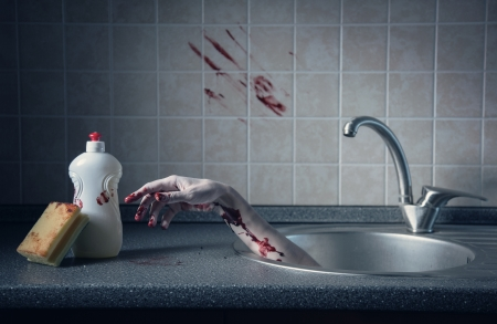 Bloody hand in kitchen sink, Halloween concept or crime scene