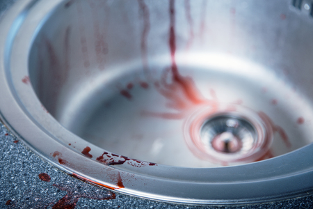 Close-up shot of bloody kitchen sink, Halloween or crime theme