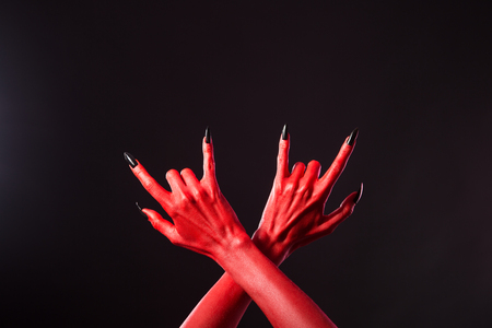 death metal: Red devil hands showing heavy metal gesture, Halloween theme