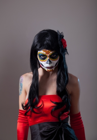 Sugar skull girl with red rose, Mexican Day of the Dead or Halloween  photo