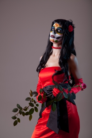 Sugar skull girl in red evening dress, Halloween shot   photo