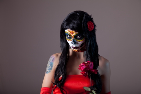 Portrait of sugar skull girl with red rose, Day of the Dead Halloween theme  photo