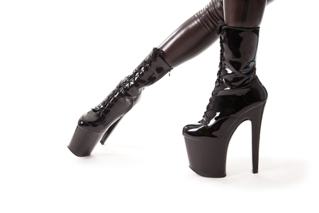 Female legs in latex stockings and high heel boots, isolated on white  photo