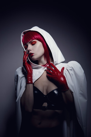 Sensual fetish woman wearing white hooded jacket, artistic noire style shot  photo