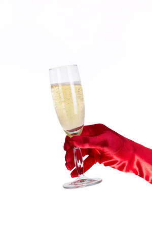 opera: Female hand in red opera glove holding champagne glass, isolated on white background  Stock Photo