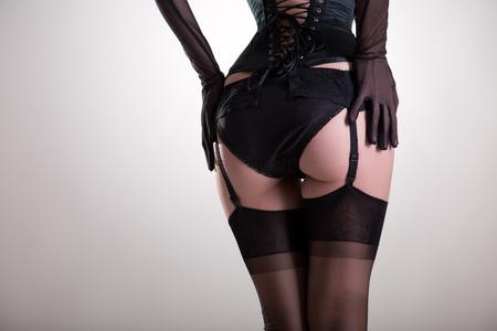 Close-up shot of sexy female buttocks in vintage lingerie, studio shot on white background   Reklamní fotografie