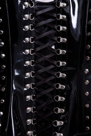 Close-up shot of black waist training leather corset   photo