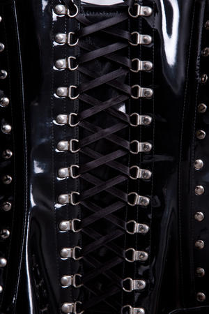 boned: Close-up shot of black waist training leather corset
