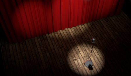 3d stage with red curtain and vintage microphone in spot light, top view  photo