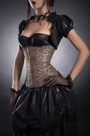 Elegant woman in Victorian style clothes and rose corset, studio shot  photo