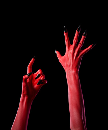 creepy hand: Red spooky devil hands with black nails, Halloween theme, isolated on black background