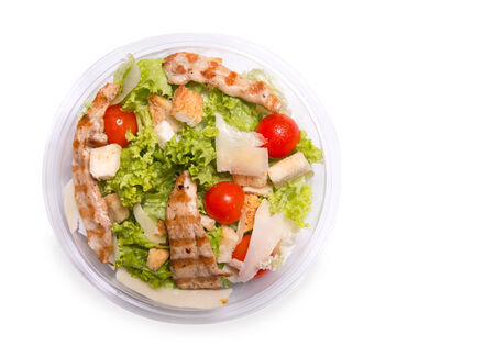 CHICKEN CAESAR SALAD: Caesar salad with grilled chicken meat, top view isolated on white background Stock Photo