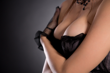 sexy breast: Close-up shot of a busty woman in beautiful lingerie, studio shot