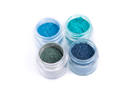 Set of mineral eye shadows in blue color, isolated on white background photo