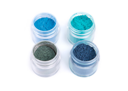 Mineral eye shadows in blue color, isolated on white background photo