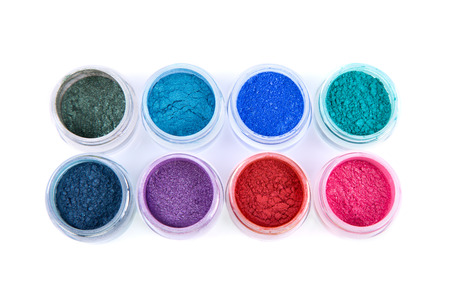 Set of colorful powder eye shadows, top view isolated on white background Stock Photo