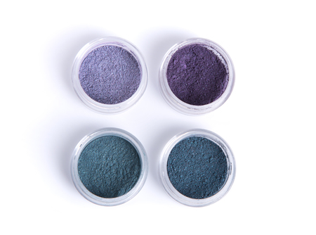 Mineral eye shadows in pastel colors, top view isolated on white background photo