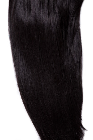 strand of hair: Texture of healthy black straight hair, soft focus