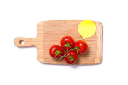 Top view of fresh tomatoes on chopping board with speech bubble isolated on white background photo