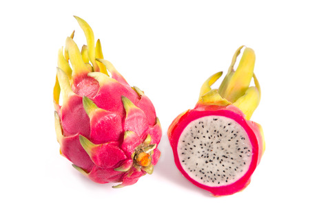 Whole and cut dragon fruits, isolated on white background photo