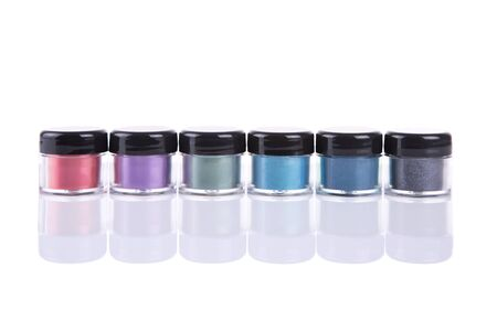 eyeshades: Set of mineral eye shadows in clear plastic jars, isolated on white background with natural reflection