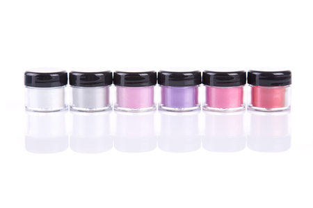 eyeshades: Bright mineral eye shadows in clear plastic jars, isolated on white background with natural reflection